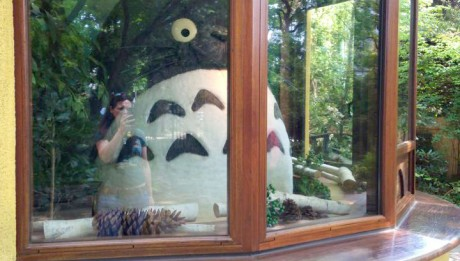 Totoro is at the Front Ticket booth when you walk up to the Ghibli Museum =]